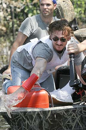 Sean Penn bails his leaky boat with a plastic cup