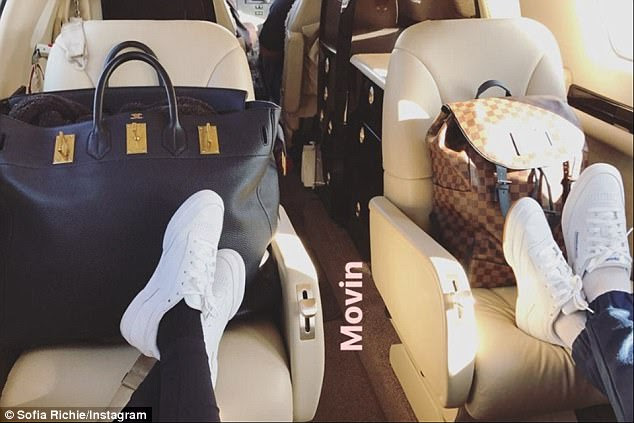 Humble:Sofia shared a snap of her large Hermes Birkin bag and Scott's Louis Vuitton backpack to her Instagram story
