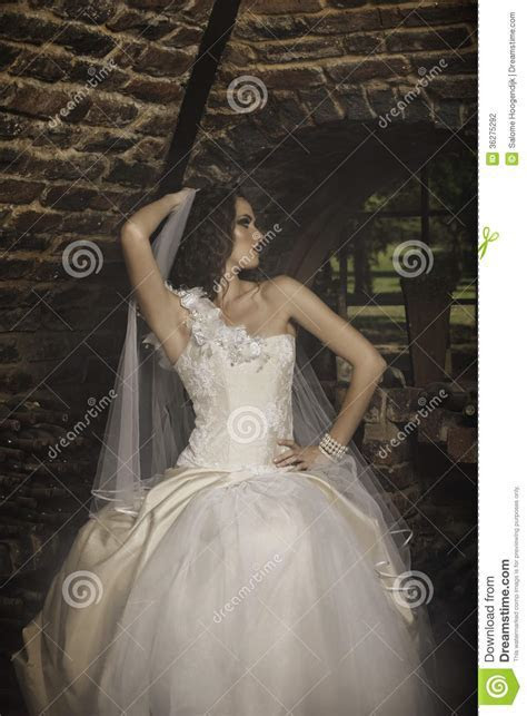 Beautiful Woman In Cream And White Wedding Dress Stock