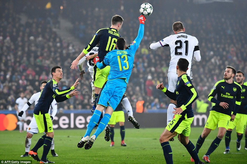 David Ospina rushes out of his goal to punch the ball clear as he attempts to clear the danger away from his goal
