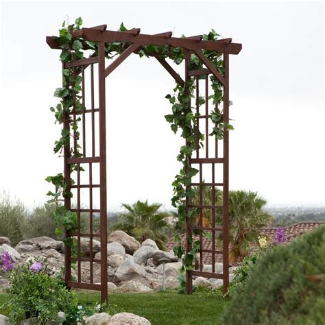wedding arbor with grapevine!! :)   Ceremony decorations