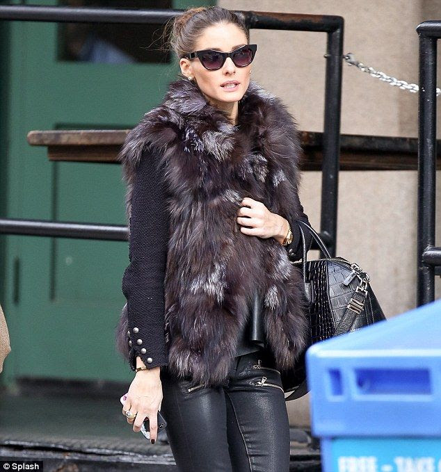 See my vest, see my vest: Olivia steps out in New York on Tuesday wearing a fur vest, leather pants and carrying a crocodile skin purse