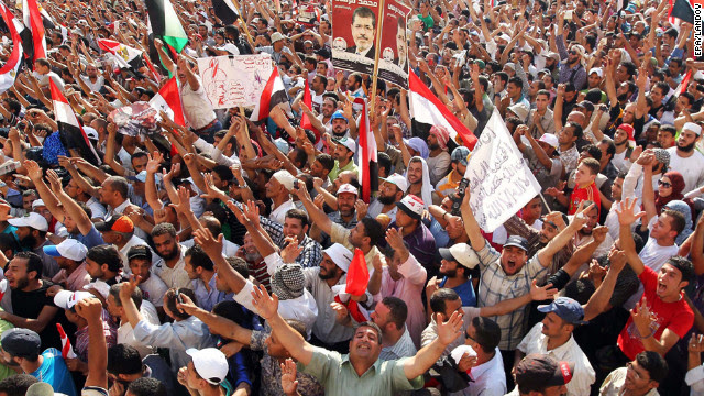 Muslim Brotherhood supporters cheer in Cairo's Tahrir Square on Sunday, June 24, after hearing of Mohammed Morsi's victory in Egypt's presidential election.