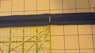 curved zipped pouch