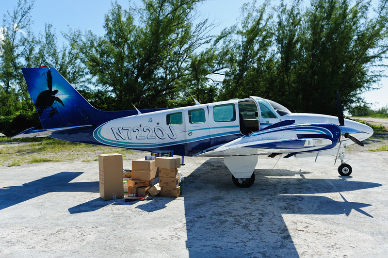 Delivering goods at Norman's Cay, Exumas, Bahamas