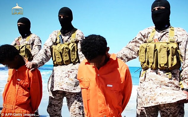 The men are held at the neck and forced to kneel by fighters in combats with balaclavas covering their faces