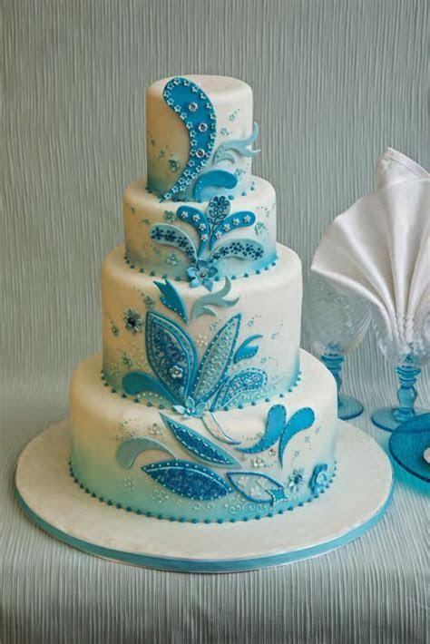 Large white cake with turquoise blue & light blue paisley