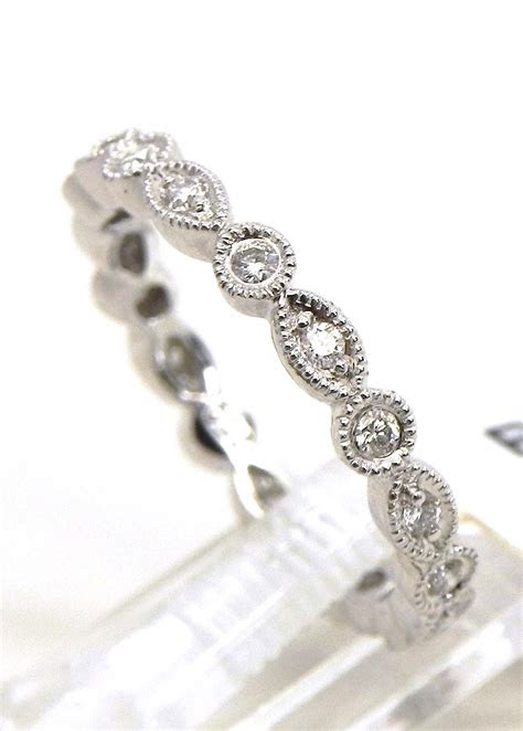ladies  white gold diamonds  oval eternity