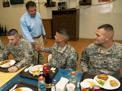 Defense Secretary Leon Panetta greets enlisted soldiers during a visit to Camp Victory in Baghdad in July 2011.