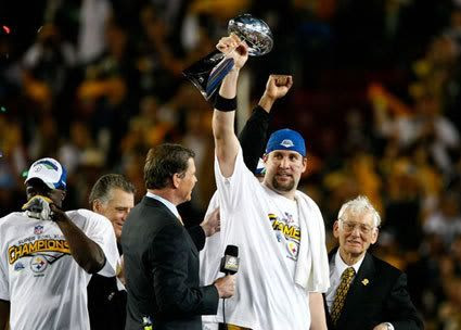 Steelers quarterback Ben Roethlisberger celebrates with the NFL Trophy after his team won 27-23 against the Arizona Cardinals in Super Bowl XLIII, on February 1, 2009.