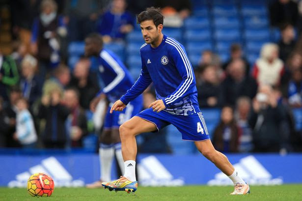 Cesc Fabregas warms up