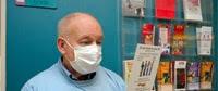 Photo: Man reading a TB brochure