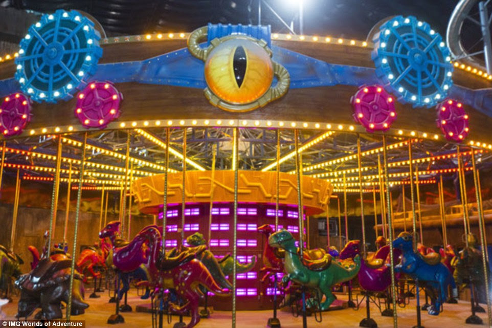 The new 1.5 million-square-foot indoor amusement park, located on the city's desert outskirts, will open on August 15. Pictured is the park's carousel, which features dinosaurs instead of horses to ride upon
