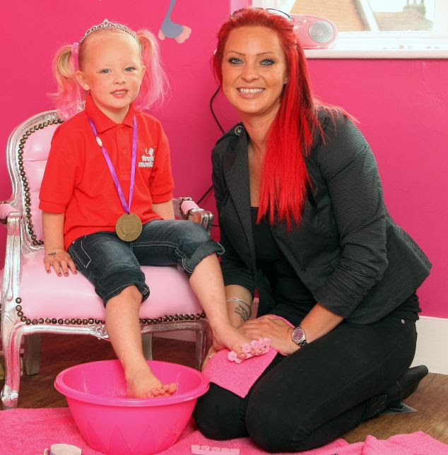 Owner Michelle gives her daughter Bailey a foot spa