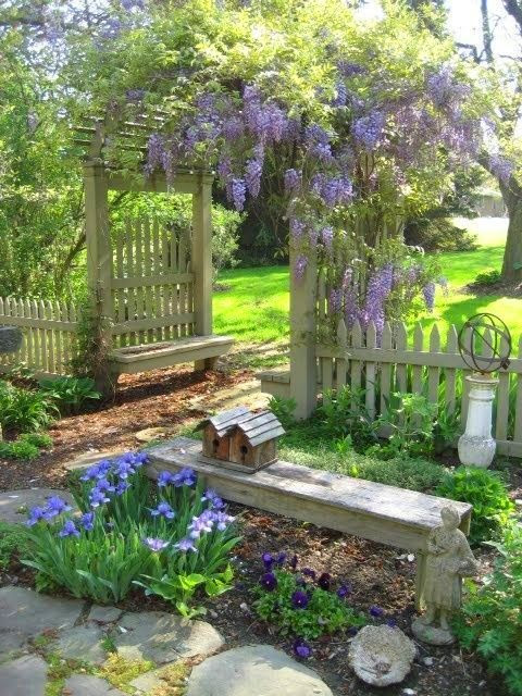 country cottage ~ is that wisteria or lilac over the trellis?
