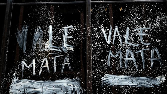 """""""Vale kills,"""" reads a slogan smeared on the mining company's headquarters in Rio de Janeiro on November 16, 2015, as Brazilians protested in the aftermath of a November 5 dam rupture that drowned a Minas Gerais village in mud"""