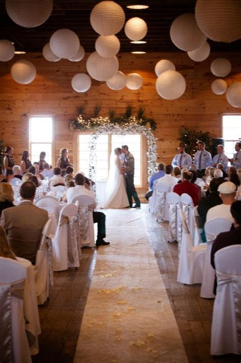 Rustic winter wedding venue, people sit in tables for