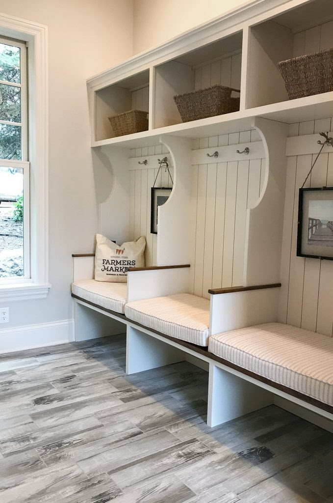 artisan home tour shiplap mudroom with cubbies and hooks gray wood floor 679x1024