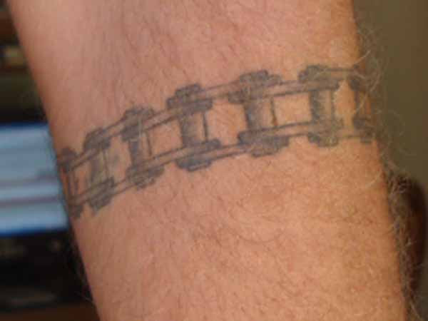 Attractive Grey Ink Chain Tattoo On Arm