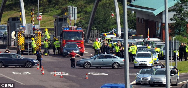Probe: An area near the toll plaza is cordoned off while police launch an investigation this morning