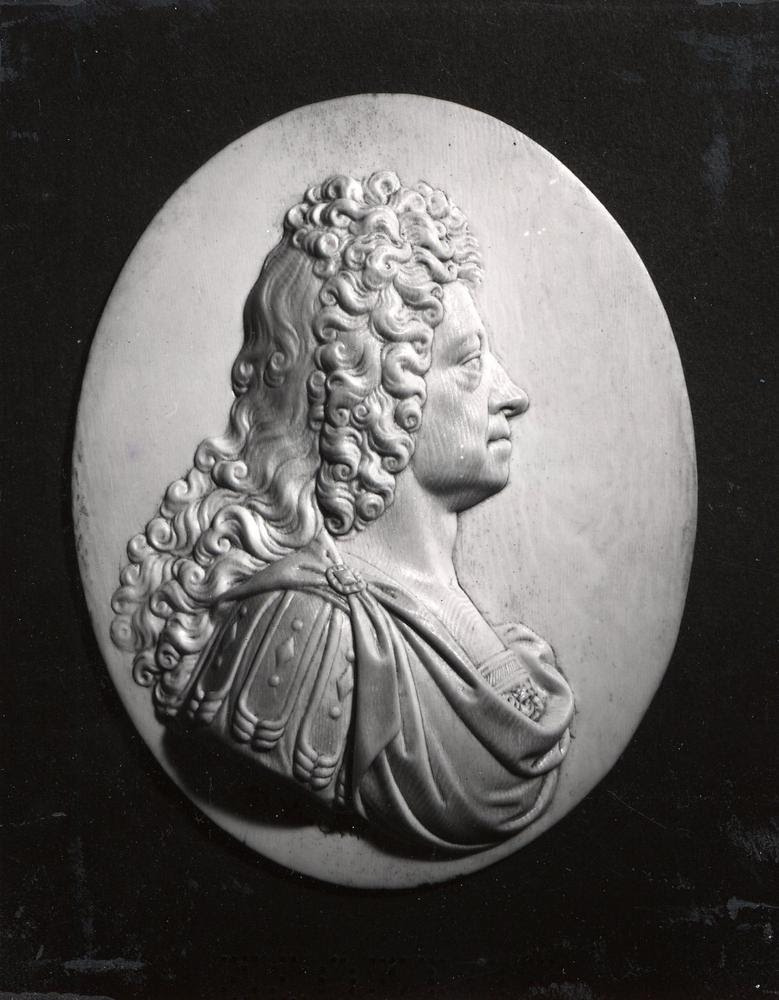 Portrait medallion of George I (1660-1727) by David le Marchand (1674-1726); carved in ivory; signature; oval plaque on back.