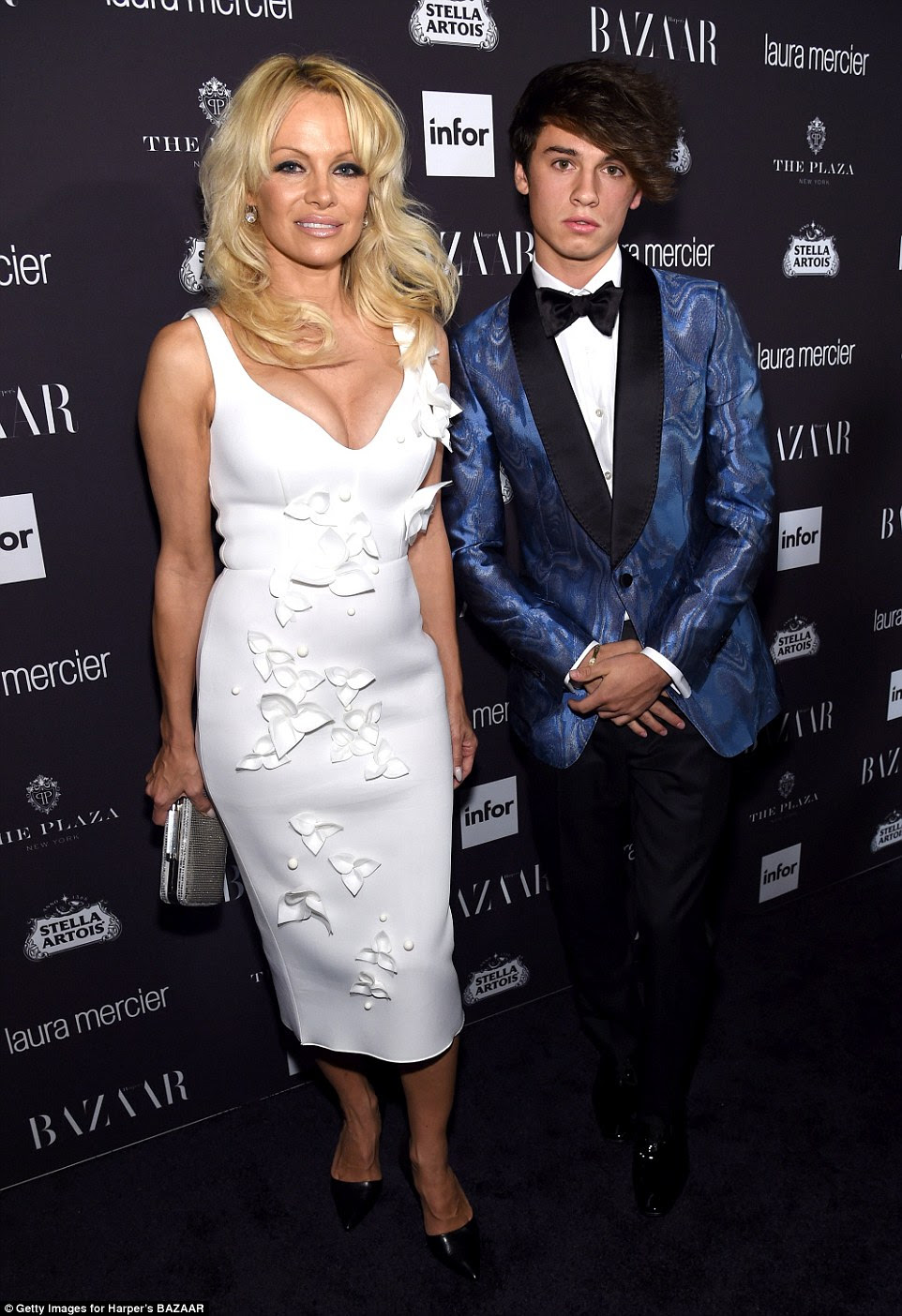 Mother and son: Pamela Anderson brought her son Dylan Jagger Lee as her date for the evening. The 18-year-old looked dapper next to his famous mother in a navy blue tux jacket and black trousers with coordinating bow tie