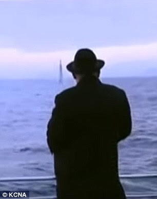 Kim Jong Un watches a submarine-launched ballistic missile