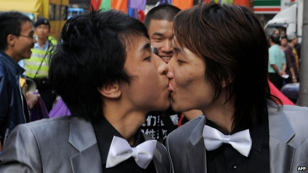 File photo: Rally participants take part in a gay and lesbian rally through the streets in Hong Kong on 13 December 2008