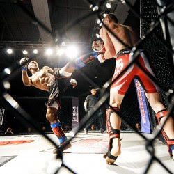Carl Langston, left, fights Sheldon Bang of Auburn during a 145- pound matchup in Lewiston on Saturday. Bang won his debut fight by unanimous decision.