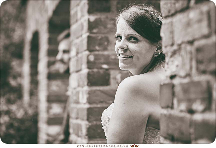 Bride looking over shoulder in black  white - www.helloromance.co.uk