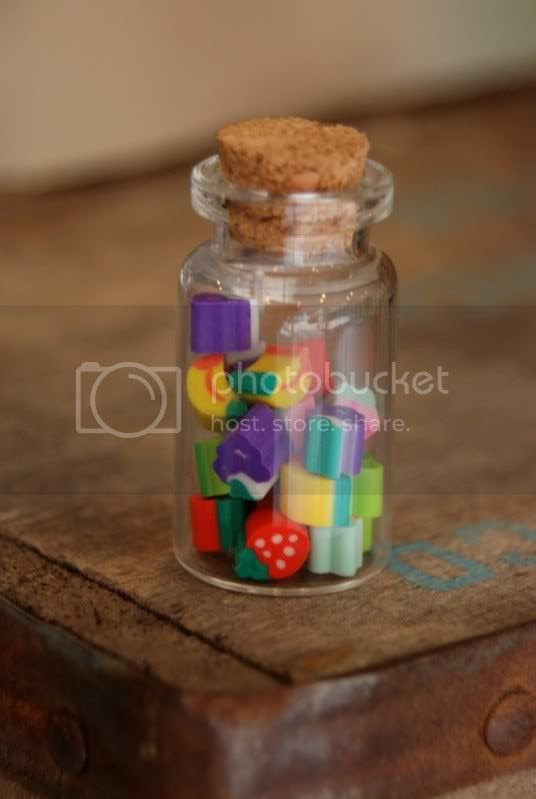 the yellow brick road glass bottle of mini erasers