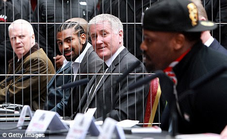 Line up: Haye and Chisora were kept apart by a metal fence