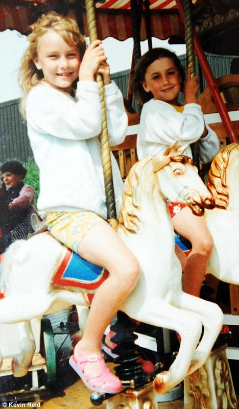 Childhood fun: Elspeth, left, and her sister enjoy at day out at the fair