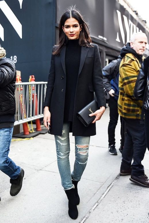 Le Fashion Blog Street Style Model Off Duty Cris Urena Nyfw Oversized Black Blazer Turtleneck Sweater Saint Laurent Clutch Ripped Jeans Boots Via Shopstyle