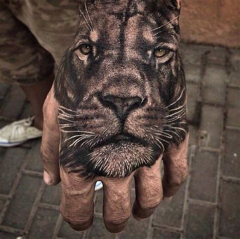 ultra realistic tiger hand tattoo atbge
