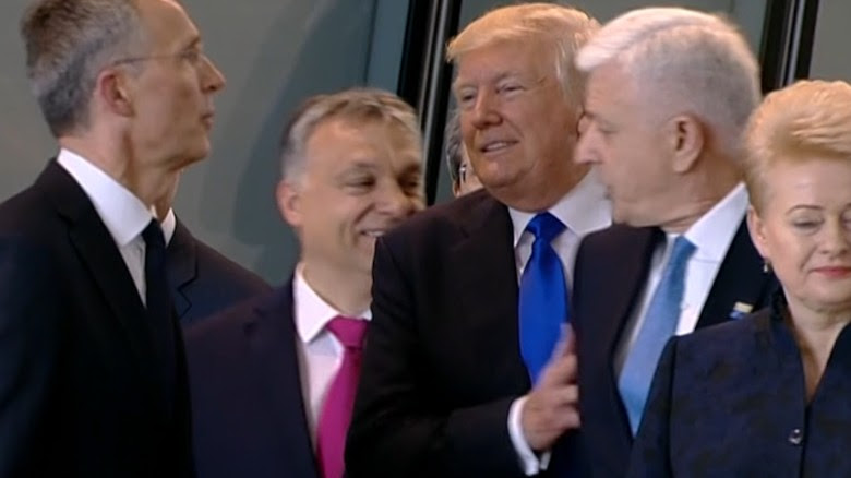 Image result for Trump pushes the prime minister
