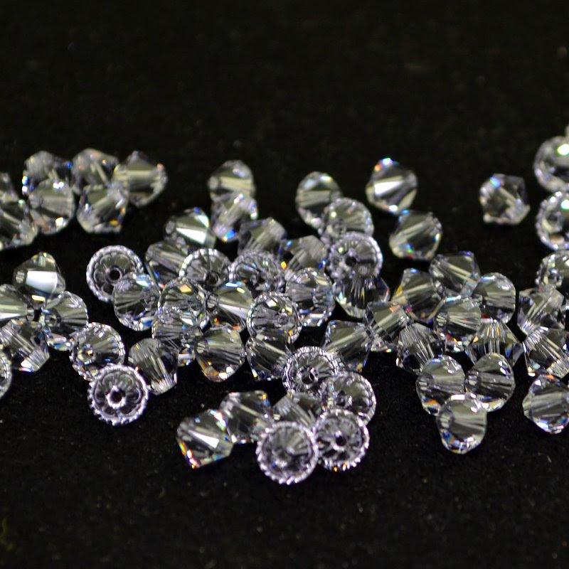 27753011777265 Swarovski Elements Bead - 5 mm Faceted Xilion Bicone (5328) - Smokey Mauve (20)