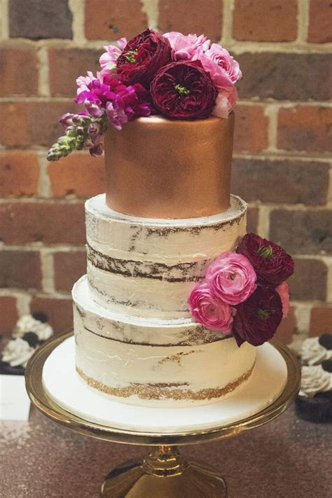 gold semi naked wedding cake with pink and burgundy