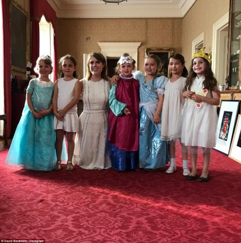 Friends in high places: Once inside, she posed with her friends and Princess Eugenie in a small drawing room inside the palace