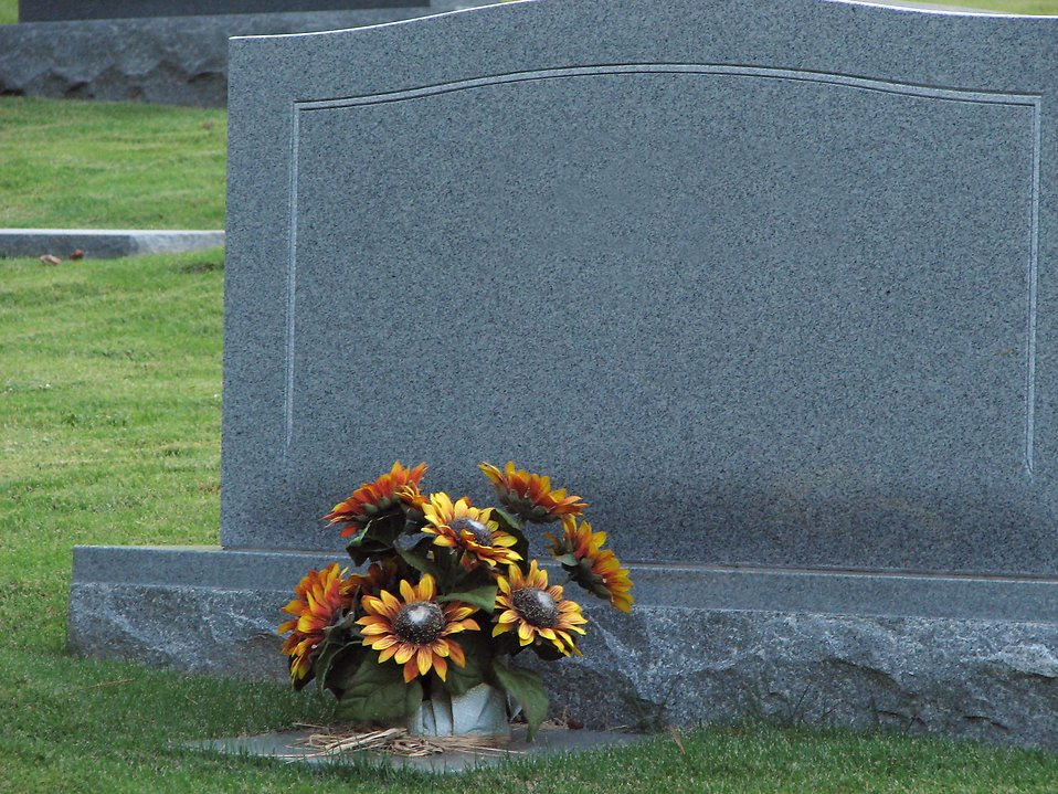 Tombstone | Free Stock Photo | A blank tombstone with flowers | # 575
