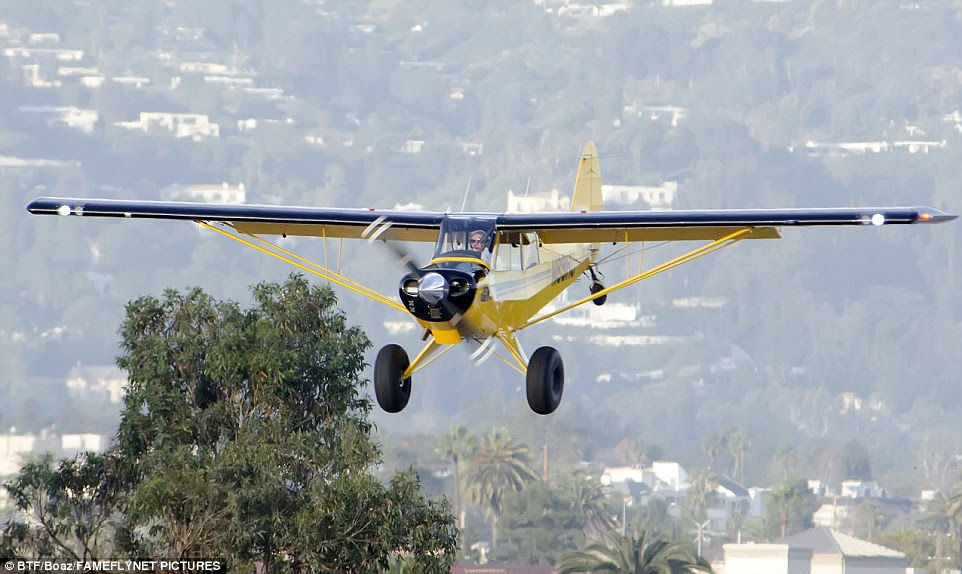 Ford (pictured flying over Santa Monica Monday before the incident) 'completely misjudged the runway' according to a witness at the airport who saw the actor's harrowing near miss with a Boeing 737