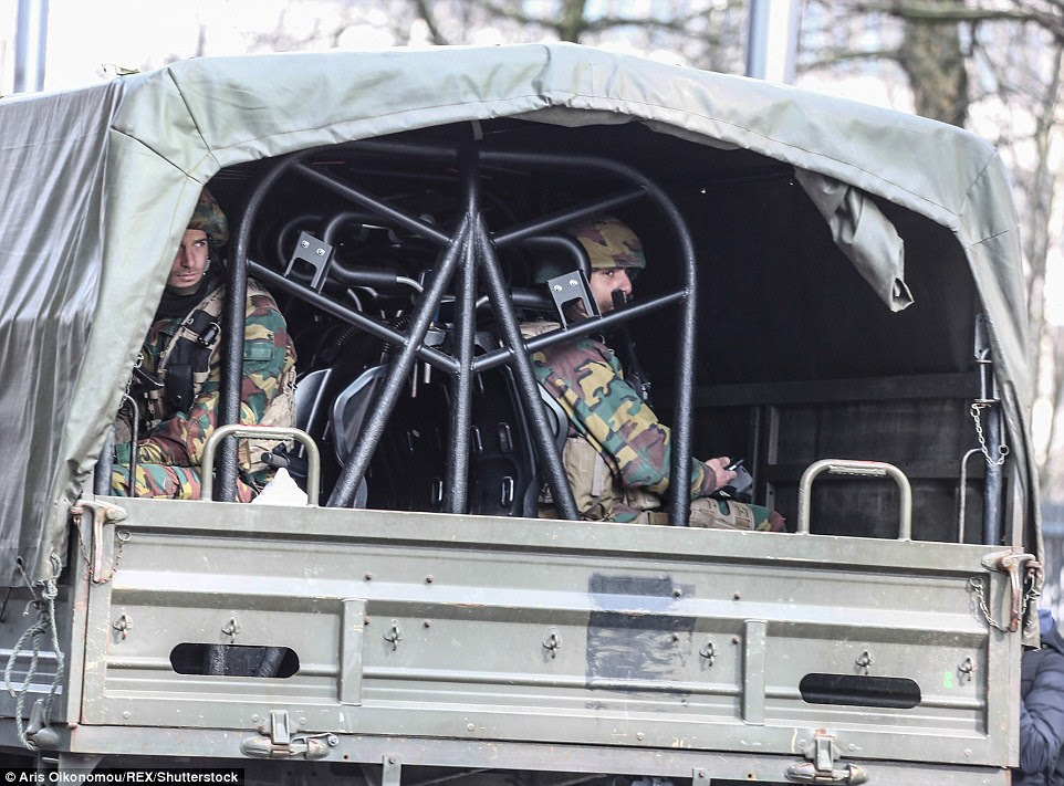 Deployment: Scores of armed forces have flooded the streets of Brussels as suspects remain at large
