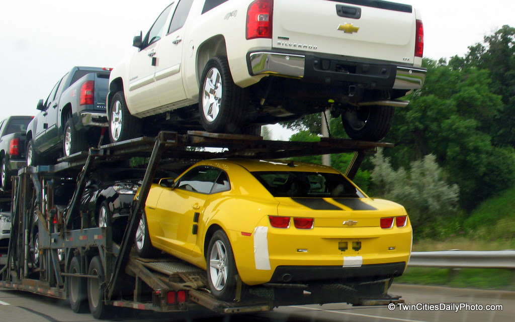 Which one would you rather have, the Silverado truck or the yellow Camaro?