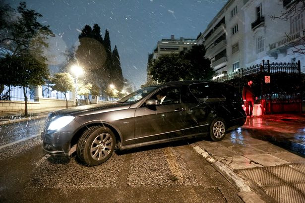 A hearse leaves a residence block where Russian consul Andrey Malanin was found dead in his apartment in Athens