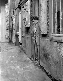 Giacometti in the entrance of his studio, ca. 1950