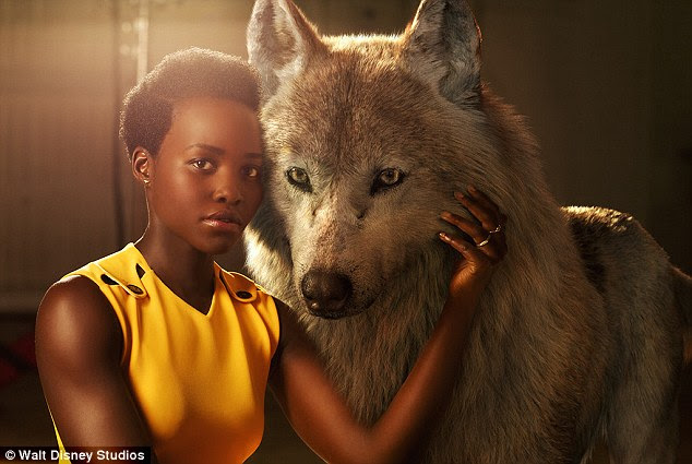 Luminous: The Jungle Book Lupita Nyong'o posed alongside her onscreen alter ego, Raksha, who is described as 'a mother wolf who cares deeply for all her pups, including man-cub Mowgli'