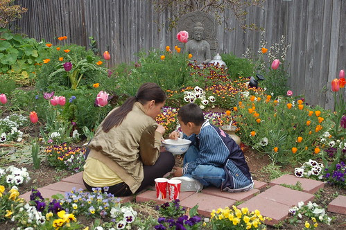 A Mom and Son Sharing Noodle Soup In The Temple Garden