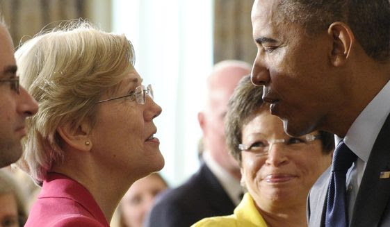 Sen. Elizabeth Warren, D-Mass., left, talks with President Barack Obama following a statement with Richard Cordray, the new director of the Consumer Financial Protection Bureau, in the State Dining Room of the White House in Washington. (AP Photo/Susan Walsh, File)