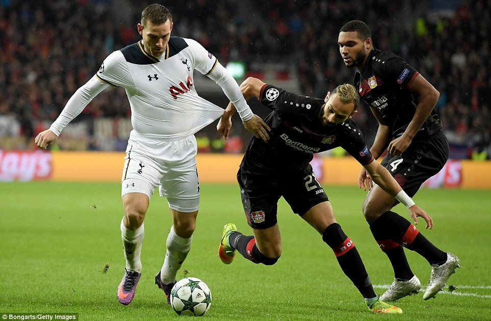 Janssen battles on with the ball just outside the area as Leverkusen defender Toprak tugs on the Dutchman's shirt