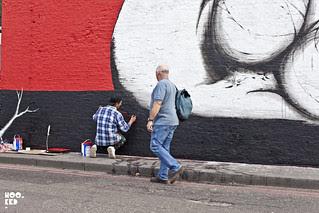 Italian street artist Run paints a new mural on East London's iconic  Village Underground Wall.